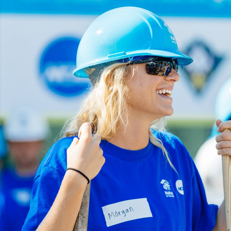 WILMINGTON, North Carolina (4/27/2019) - Student athlete volunteers from University of North Carolina Wilmington (UNCW), and the NCAA work on two different homes with Habitat for Humanity Cape Fear.